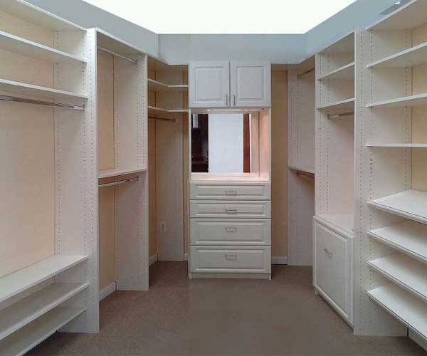 White walk in closet with custom doors