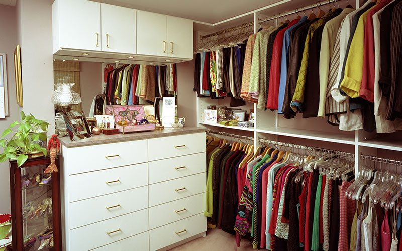 White Closet with hanging units,drawers and wall Cabinets